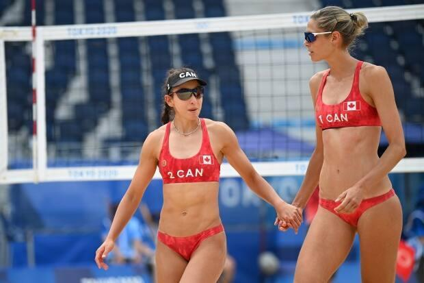 Sarah Pavan, right, and Melissa Humana-Paredes, left, shown in this file photo from the Tokyo Olympics, won their first two matches at the beach volleyball World Tour Finals in Sardinia, Italy on Wednesday. (Matthias Hangst/Getty Images - image credit)