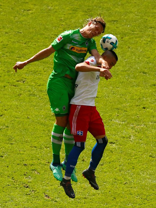 Soccer Football - Bundesliga - Hamburger SV v Borussia Moenchengladbach - Volksparkstadion, Hamburg, Germany - May 12, 2018 Borussia Monchengladbach's Jannik Vestergaard in action with Hamburg's Bobby Wood REUTERS/Morris Mac Matzen DFL RULES TO LIMIT THE ONLINE USAGE DURING MATCH TIME TO 15 PICTURES PER GAME. IMAGE SEQUENCES TO SIMULATE VIDEO IS NOT ALLOWED AT ANY TIME. FOR FURTHER QUERIES PLEASE CONTACT DFL DIRECTLY AT + 49 69 650050