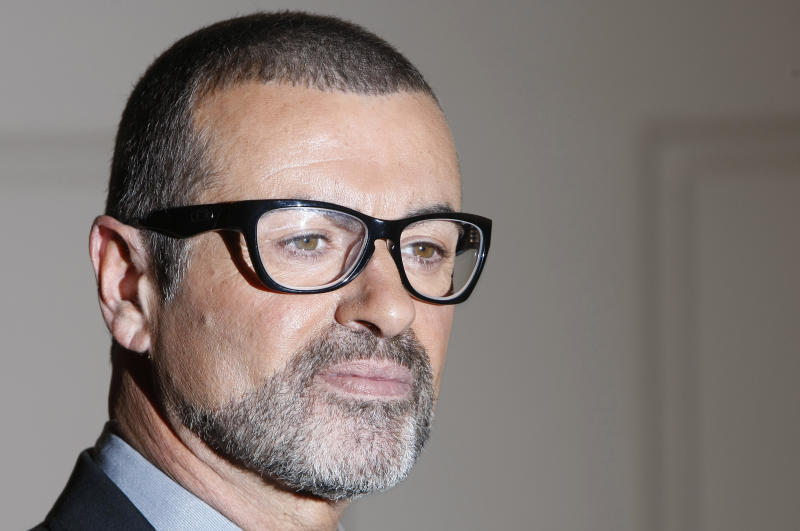 FILE - In this May 11, 2011 file photo British singer George Michael poses for the cameras at an event to announce his European Orchestral tour in London. Austria's state broadcaster says British pop star George Michael has been released from a Vienna hospital and will be able to celebrate Christmas at home. Michael, 48, was being treated for pneumonia. Broadcaster ORF says he was released Thursday, Dec. 22, 2011 from the AKH hospital and is catching a flight to London later in the day. (AP Photo/Alastair Grant, File)