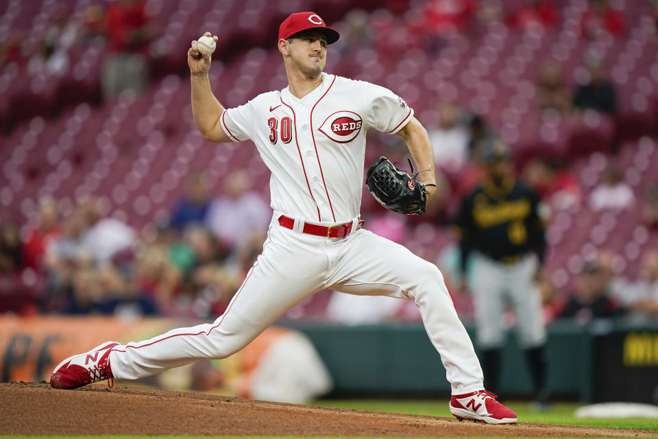 Cincinnati Reds' starting pitcher Tyler Mahle (30) throws during the first inning of a baseball game against the Pittsburgh Pirates in Cincinnati, Tuesday, Sept 21, 2021. (AP Photo/Bryan Woolston)