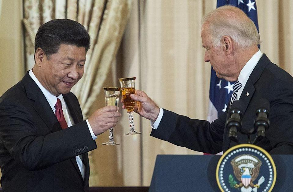 <p>Joe Biden and Chinese President Xi Jinping toast during a state luncheon for China in 2015</p> (AFP via Getty Images)