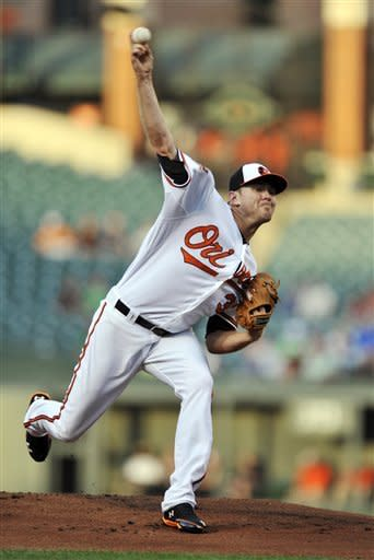 Baltimore Orioles starting pitcher Chris Tillman throws against the Seattle Mariners in the first inning of a baseball game, Monday, Aug. 6, 2012, in Baltimore. (AP Photo/Gail Burton)