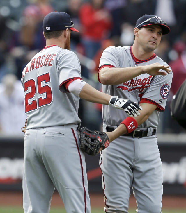 Washington Nationals' Adam LaRoche, left, and Ryan Zimmerman celebrate after the baseball game against the New York Mets at Citi Field, Thursday, April 3, 2014, in New York. The Nationals won 8-2. (AP Photo/Seth Wenig)