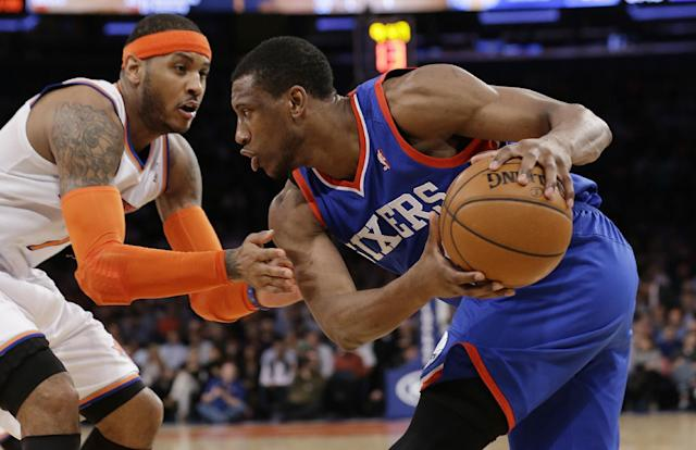 New York Knicks' Carmelo Anthony (7) defends Philadelphia 76ers' Thaddeus Young (21) during the second half of an NBA basketball game Monday, March 10, 2014, in New York. (AP Photo/Frank Franklin II)