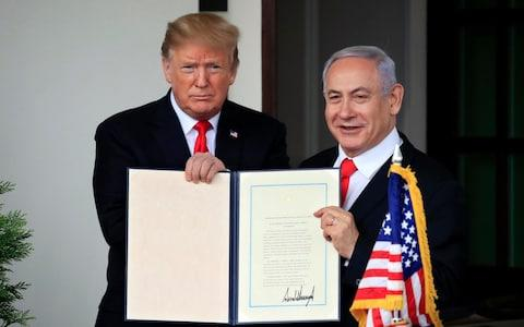 <span>Donald Trump and Mr Netanyahu after the US recognised Israeli sovereignty over the Golan Heights</span> <span>Credit: AP Photo/Manuel Balce Ceneta, File </span>