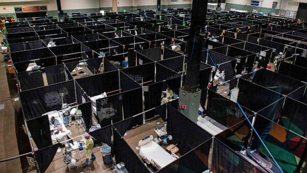 PHOTO: Inside the hot zone medical staff monitor and treat sick patients infected with the Covid-19 virus at the UMASS Memorial DCU Center Field Hospital in Worcester, Massachusetts, Jan. 13, 2021. (Joseph Prezioso/AFP via Getty Images)