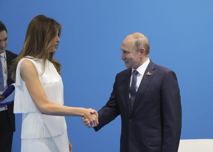 Russian President Vladimir Putin shakes hands with first lady Melania Trump during a meeting on the sidelines of the G-20 summit in Hamburg, Germany.