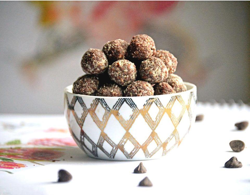 """<p>Dessert? Pre-workout snack? These nutritious bites are as sweet as they are satisfying. </p><p><a class=""""link rapid-noclick-resp"""" href=""""https://nutritionalanatalie.com/chocolate-almond-bites-3/"""" rel=""""nofollow noopener"""" target=""""_blank"""" data-ylk=""""slk:GET THE RECIPE"""">GET THE RECIPE</a></p><p><em>Per serving: 88 calories, 5 g fat (2 g saturated), 11 g carbs, 49 mg sodium, 8 g sugar, 2 g fiber, 1 g protein</em></p>"""