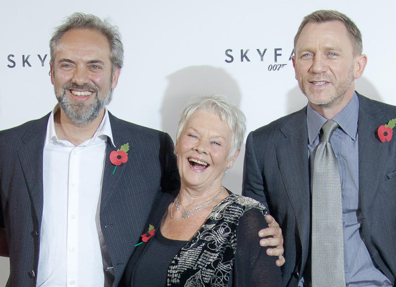 "FILE - This is a Thursday, Nov. 3, 2011. file photo of Film  Director Sam Mendes, with actors Dame Judi Dench and Daniel Craig at the photo call for the new James Bond film titled Skyfall, at a central London restaurant venue.  Never say never again? Sam Mendes says he won't be directing the next James Bond film — but may work on the series again in future. In comments published Wednesday March 6, 2013  by movie magazine Empire, Mendes said he was honored to have been part of the Bond family, ""and very much hope I have a chance to work with them again."" (AP Photo/Joel Ryan, File)"