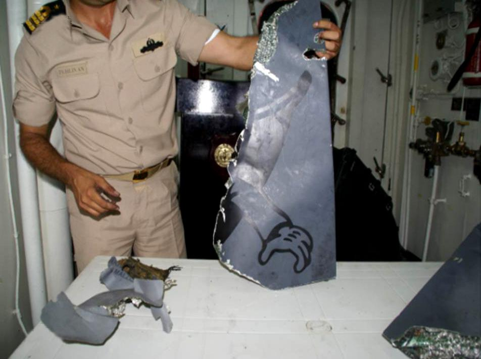 This photo taken Wednesday, July 4, 2012 and provided by the Turkish military, shows wreckage retrieved from the sea after a Turkish RF-4 Phantom jet which was shot down by Syrian forces June 22, 2012. Turkey says the plane was hit in international airspace, but Syria insists it was flying low inside Syrian airspace. The bodies of two Turkish pilots were recovered from the seabed on Thursday July 5, 2012 after U.S. ocean explorer Robert Ballard, best known for discovering the wreck of the Titanic, helped locate them nearly two weeks after their jet was shot down by Syria. A Turkish official said Ballard, aboard his deep-sea exploration vessel R/V Nautilus, found the bodies Wednesday 8.6 nautical miles off the Syrian coast after the Turkish navy had pinpointed the area. (AP Photo/Turkish Military)