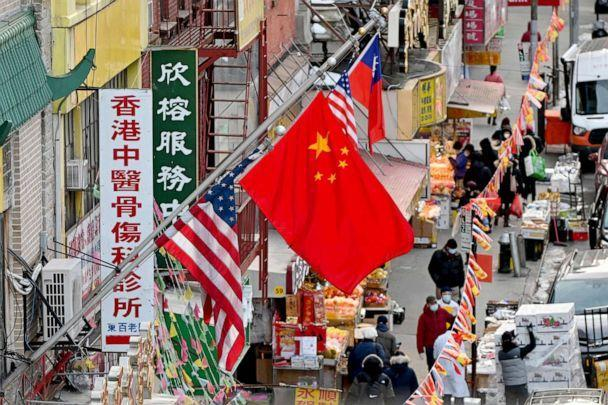 PHOTO: A Chinese flag hangs between American flags in Chinatown in New York, Feb. 17, 2021. (Angela Weiss/AFP via Getty Images, FILE)
