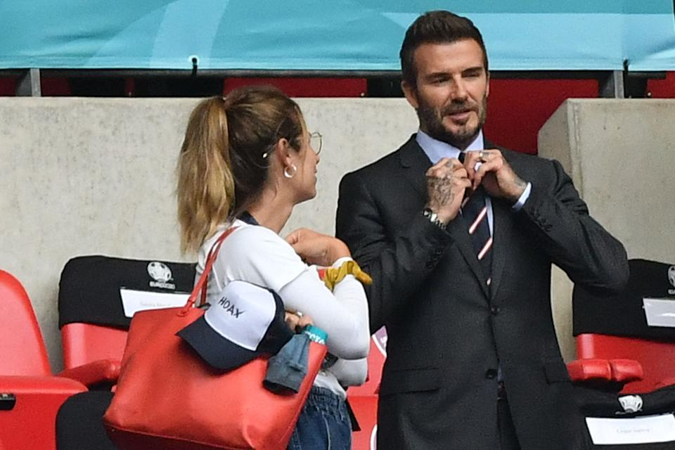 David Beckham speaks to a fan during the UEFA EURO 2020 round of 16 football match between England and Germany at Wembley Stadium in London on June 29, 2021. (Photo by JUSTIN TALLIS / POOL / AFP) (Photo by JUSTIN TALLIS/POOL/AFP via Getty Images)