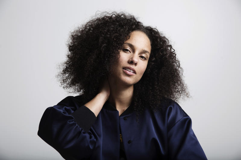 "FILE - In this Nov. 2, 2016 file photo, Alicia Keys poses for a portrait in New York. Keys' memoir ""More Myself"" with be released on Tuesday, March 31. (Photo by Taylor Jewell/Invision/AP, File)"