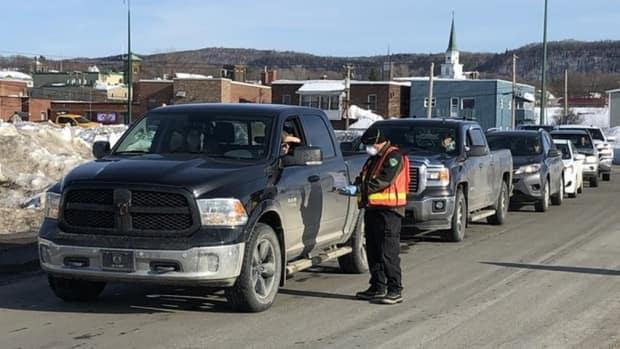 Vehicles entering New Brunswick are stopped at the Quebec border for screening.