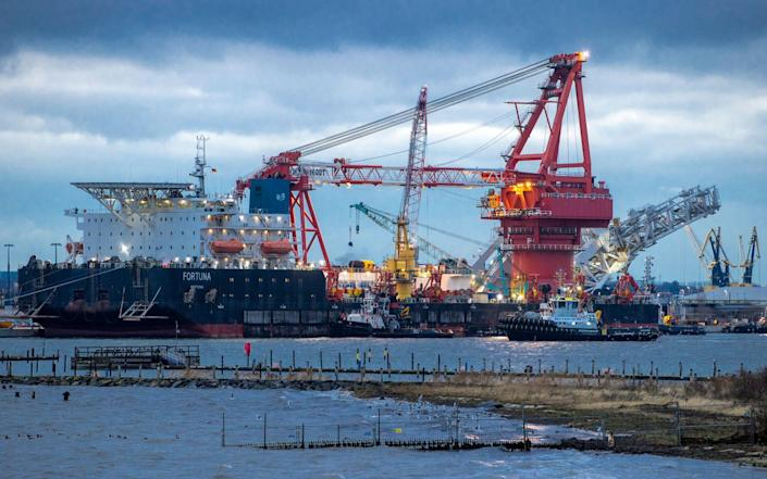 Tugboats positioned around the Russian pipe-laying vessel 'Fortuna' in the German port of Wismar, Jan 14 2021 - Jens Buettner/dpa via AP