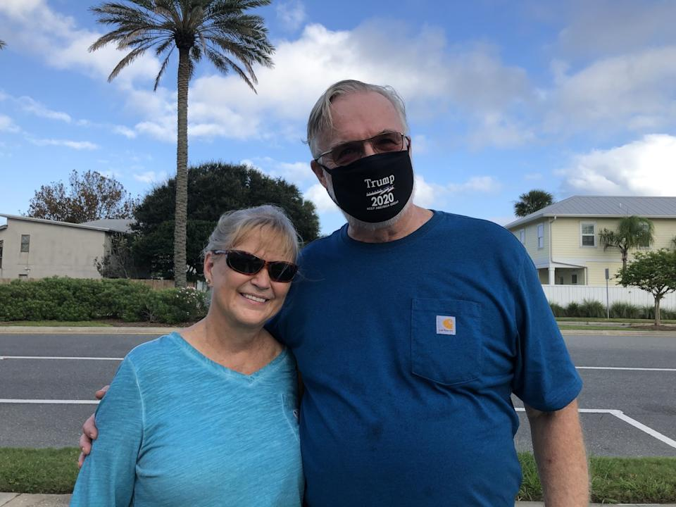 Maria and Gabe Goodman, residents of Neptune Beach, Fla., cast their ballots for President Trump early.
