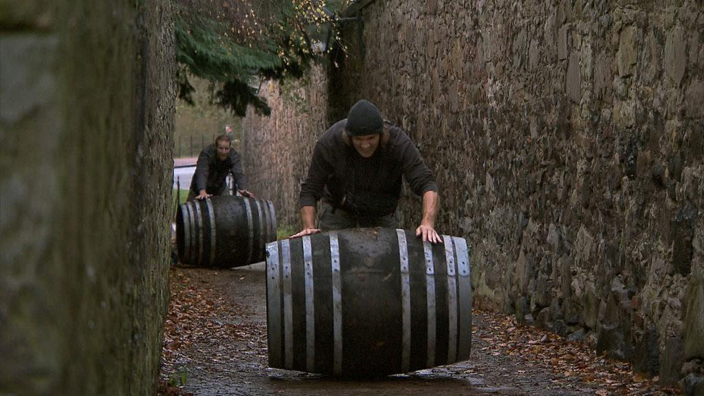 """Working Our Barrels Off"" -- In Detour B, Hockey brothers Anthony (left) and Bates (right) must deliver eight barrels of Scotch whisky to the Whisky Festival held in Duddingston Village, in order to receive the next clue, on ""The Amazing Race."""