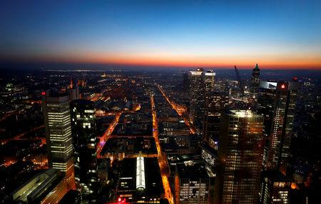 FILE PHOTO: The sun sets behind the financial district early evening in Frankfurt