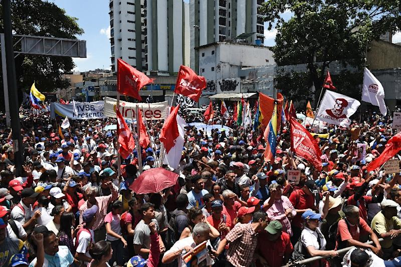 "Supporters of Nicolas Maduro rally in Caracas on April 6, 2019 in what the president called a ""March in Defense of Peace"" (AFP Photo/Federico Parra                      )"