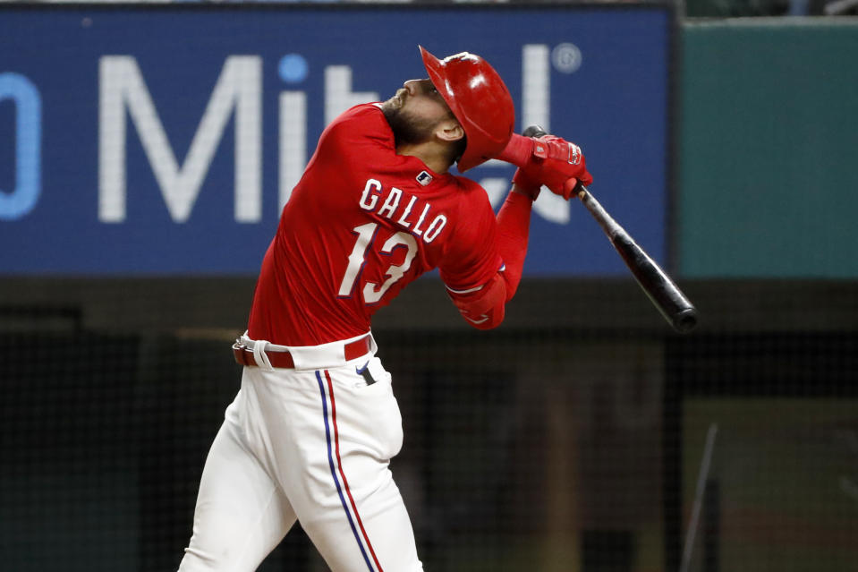 Texas Rangers Joey Gallo watches a fly ball during the ninth inning of a baseball game against the Baltimore Orioles in Arlington, Texas, Friday, April 16, 2021. Texas lost the game 5-2. (AP Photo/Roger Steinman)