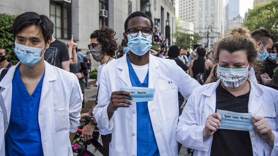 Medical workers, pictured here participating in a protest after the death of George Floyd.