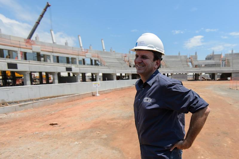 Rio de Janeiro's mayor Eduardo Paes visits the construction site of the Olympic Park for the 2016 Olympic and Paralympic games in Barra da Tijuca on December 19, 2014