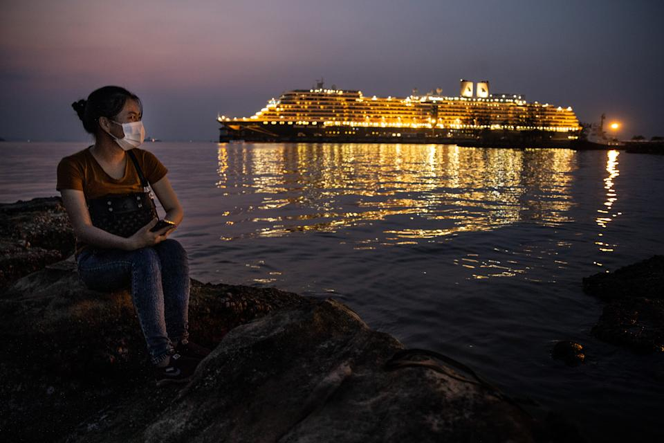 A woman views the MS Westerdam cruise ship