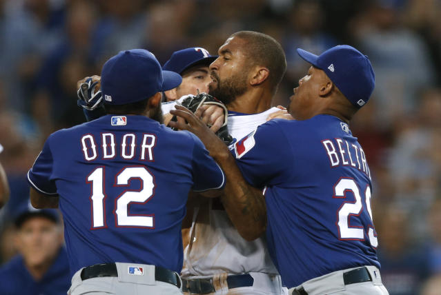Texas Rangers' Rougned Odor and Adrian Beltre restrain Los Angeles Dodgers' Matt Kemp, center, as Kemp scuffled with Rangers catcher Robinson Chirinos during the third inning of a baseball game, Wednesday, June 13, 2018, in Los Angeles. (AP Photo/Jae C. Hong)