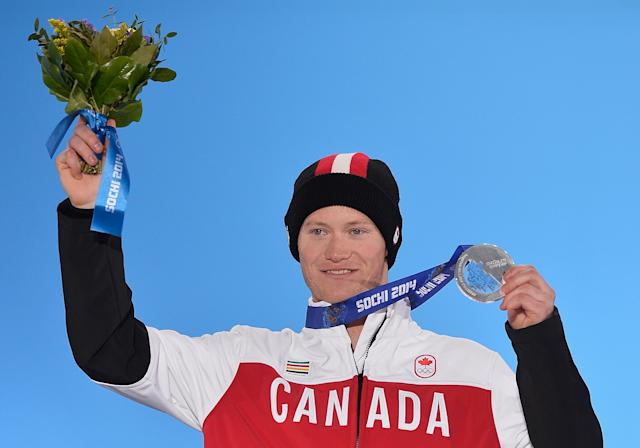 SOCHI, RUSSIA - FEBRUARY 19: Silver medalist Mike Riddle of Canada celebrates during the medal ceremony for the Men's Ski Halfpipe on day twelve of the Sochi 2014 Winter Olympics at at Medals Plaza on February 19, 2014 in Sochi, Russia. (Photo by Pascal Le Segretain/Getty Images)