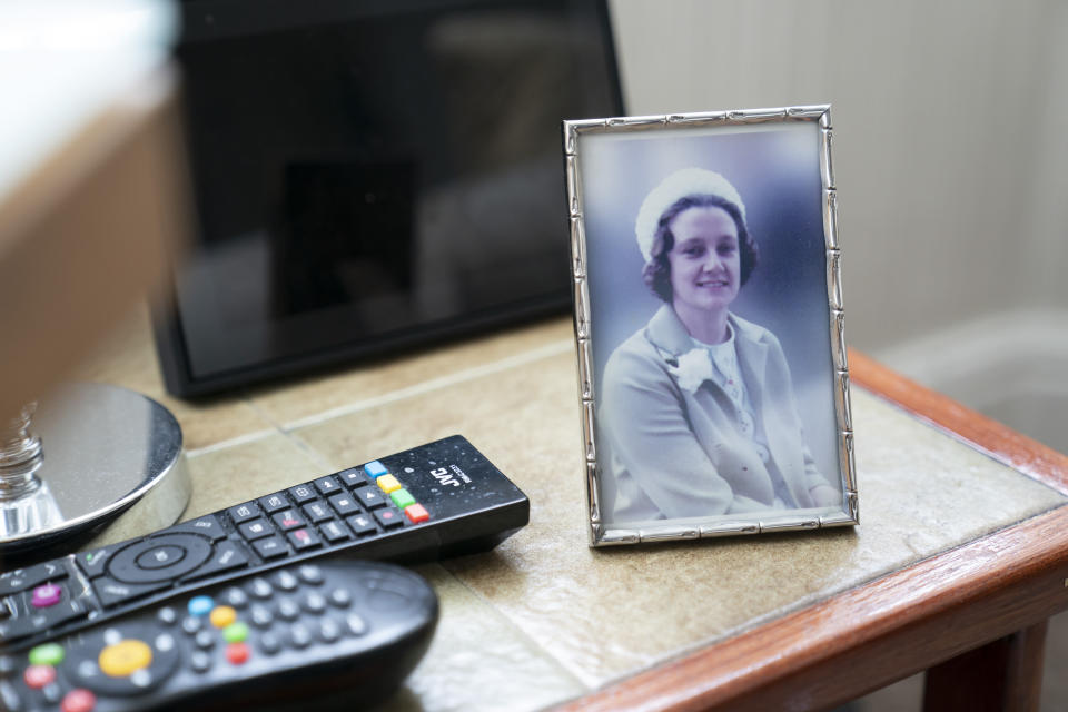 "A photo of the late Muriel Bonner taken in Belgium in 1979, stands on a table in the home of her husband Gordon Bonner, in Leeds, England Saturday Jan. 23, 2021. For nine months, Gordon Bonner has been in the ""hinterlands of despair and desolation"" after losing Muriel, his wife of 63 years, to the coronavirus pandemic that has now taken the lives of more than 100,000 people in the United Kingdom. ( AP Photo/Jon Super)"