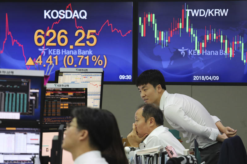 Currency traders watch monitors at the foreign exchange dealing room of the KEB Hana Bank headquarters in Seoul, South Korea, Monday, Oct. 7, 2019. Asian shares were mixed Monday, following a healthy report on U.S. jobs, while investors cautiously awaited the upcoming trade talks between the U.S. and China. (AP Photo/Ahn Young-joon)