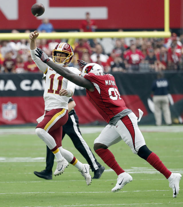 <p>Washington Redskins quarterback Alex Smith (11) throws under pressure from Arizona Cardinals defensive end Benson Mayowa during the first half of an NFL football game, Sunday, Sept. 9, 2018, in Glendale, Ariz. (AP Photo/Rick Scuteri) </p>