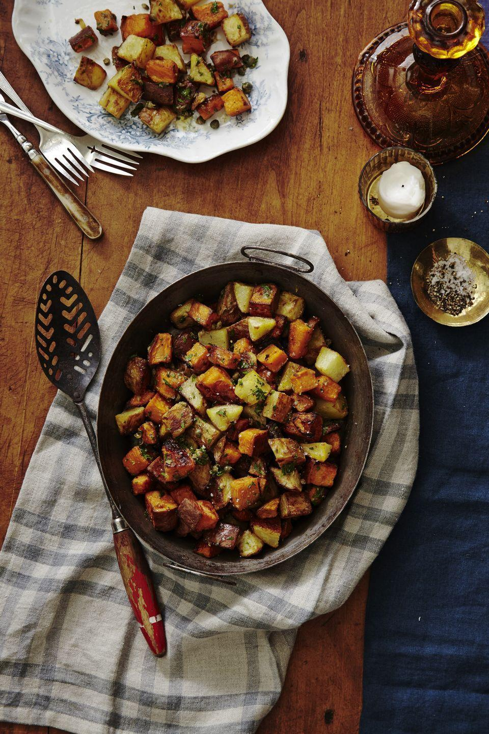 """<p>You don't always have to mash or boil and smash your spuds. Here's proof that they roast up beautifully chopped and tossed with a few key ingredients (sherry vinegar and capers). </p><p><em><a href=""""https://www.goodhousekeeping.com/food-recipes/easy/a34573/crispy-roasted-potatoes-with-caper-vinaigrette/"""" rel=""""nofollow noopener"""" target=""""_blank"""" data-ylk=""""slk:Get the recipe for Crispy Roasted Potatoes with Caper Vinaigrette »"""" class=""""link rapid-noclick-resp"""">Get the recipe for Crispy Roasted Potatoes with Caper Vinaigrette » </a></em></p>"""