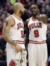 Chicago Bulls forward Luol Deng, right, talks with Carlos Boozer during the first half of an NBA basketball game against the Indiana Pacers in Chicago on Saturday, March 23, 2013. (AP Photo/Nam Y. Huh)