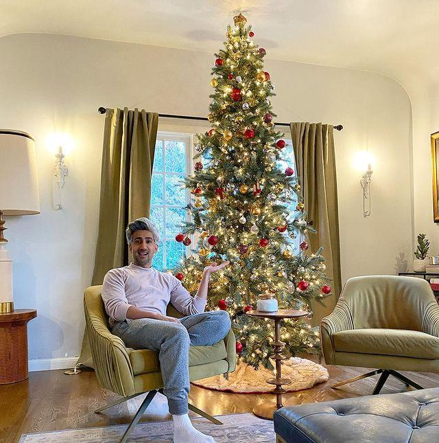 "<p>Some people go for candy, others for curated Christmas tree decor. ""10 year Halloween tradition. Christmas Tree goes up. Haters back off!!"" the <em>Queer Eye</em> star wrote alongside a photo of his stunning tree on Oct. 1. </p>"