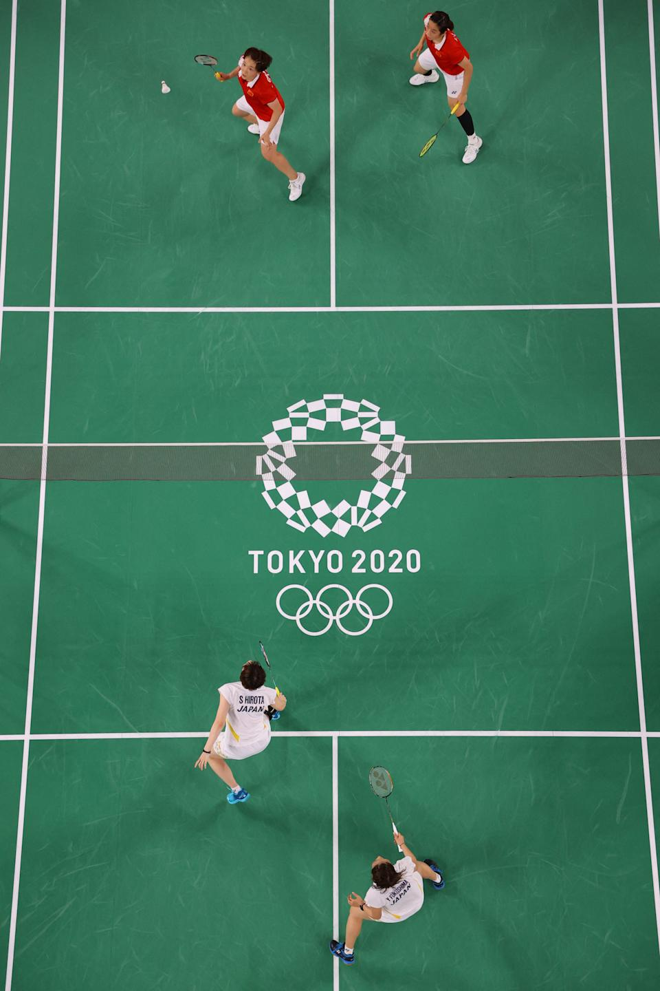 <p>China's Chen Qingchen (top L) hits a shot next to China's Jia Yifan in their women's doubles badminton quarter final match against Japan's Yuki Fukushima and Japan's Sayaka Hirota during the Tokyo 2020 Olympic Games at the Musashino Forest Sports Plaza in Tokyo on July 29, 2021. (Photo by LINTAO ZHANG / POOL / AFP) (Photo by LINTAO ZHANG/POOL/AFP via Getty Images)</p>