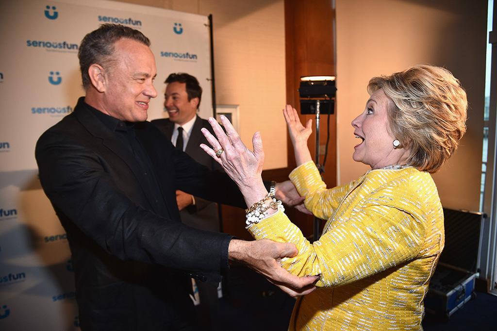<p>Clinton was thrilled to encounter her friend Tom Hanks at a children's charity event in May, in case you can't tell. But then, who <em>wouldn't</em> be happy to run into that guy? (Photo: Kevin Mazur/Getty Images for SeriousFun) </p>
