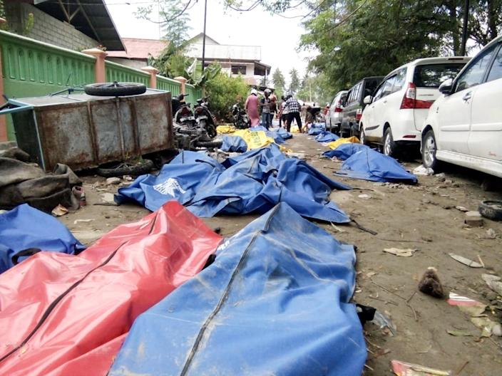 <p>Dead bodies as seen at a street after earthquake hit in Palu, Indonesia on Sept. 29, 2018. (Photo: Stringer/Reuters) </p>