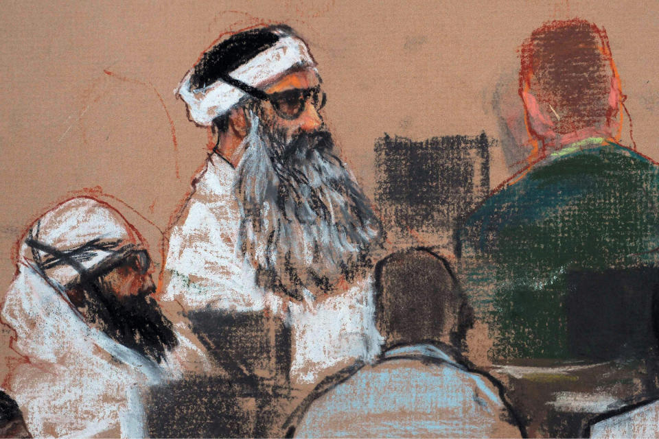 FILE - This Monday, Dec. 8, 2008 courtroom drawing by artist Janet Hamlin and reviewed by the U.S. military, shows Khalid Sheikh Mohammed, center, and co-defendant Walid Bin Attash, left, attending a pre-trial session at Guantanamo Bay Naval Base, Cuba. Mohammed is the alleged mastermind of the Sept. 11, 2001, attacks. His trial date has been postponed again and again. He remains at Guantanamo, indefinitely. (AP Photo/Janet Hamlin, Pool, File)