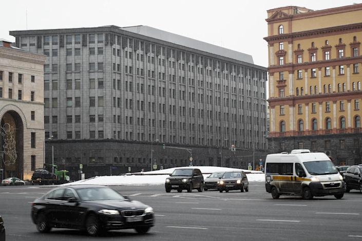 FILE - In this Friday, Dec. 30, 2016 file photo FSB headquarters, grey building at center, in downtown Moscow, Russia. Moscow has been awash with rumours of a hacking-linked espionage plot at the highest level since cyber-security firm Kaspersky said one of its executives with ties to the Russian intelligence services had been arrested on treason charges. (AP Photo/Alexander Zemlianichenko, File)