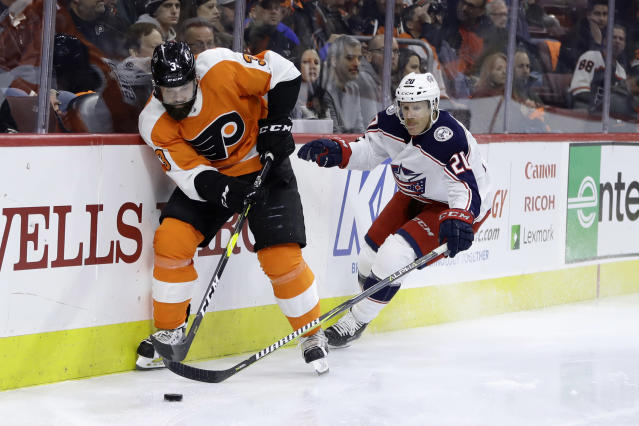 Philadelphia Flyers' Radko Gudas, left, and Columbus Blue Jackets' Riley Nash vie for the puck during the third period of an NHL hockey game Thursday, Dec. 6, 2018, in Philadelphia. Columbus won 4-3 in overtime. (AP Photo/Matt Slocum)