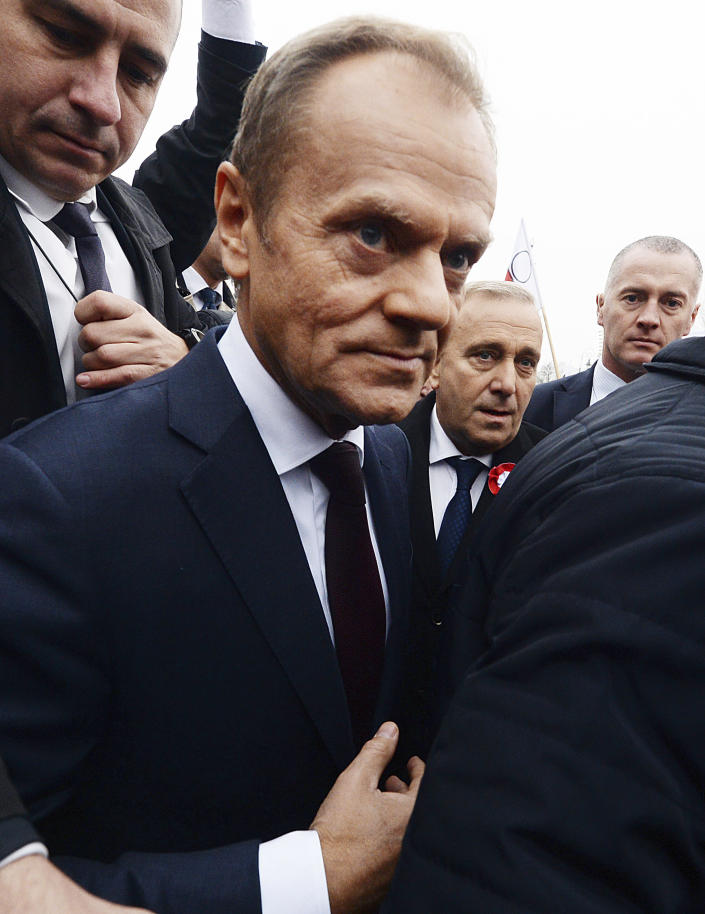 Donald Tusk, ex-Polish prime minister and president of the European Council, walks, after laying flowers by the statue of Marshal Jozef Pilsudski on the centenary of Polish independence in Warsaw, Poland, Sunday, Nov. 11, 2018. Pilsudski was the Polish leader who led Poland in regaining its lost statehood at the end of World War I after more than a century of rule by foreign powers. (AP Photo/Czarek Sokolowski)