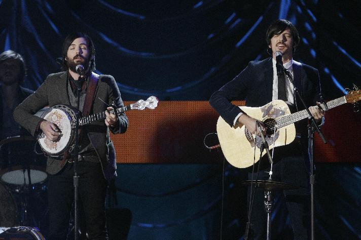 """FILE - This Nov. 29, 2011 file photo shows Scott Avett, left, and Seth Avett of The Avett Brothers performing at the CMT Artists of the Year television taping in Nashville, Tenn. Their latest album """"The Carpenter,"""" was released this month. (AP Photo/Mark Humphrey, file)"""