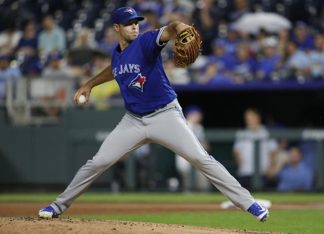 Toronto Blue Jays pitcher Sam Gaviglio throws to a Kansas City Royals batter during the first inning of a baseball game at Kauffman Stadium in Kansas City, Mo., Thursday, Aug. 16, 2018. (AP Photo/Colin E. Braley)