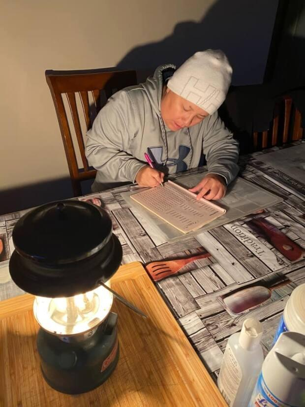 Residents found a variety of light sources and activities to keep themselves busy in the days the power was out.
