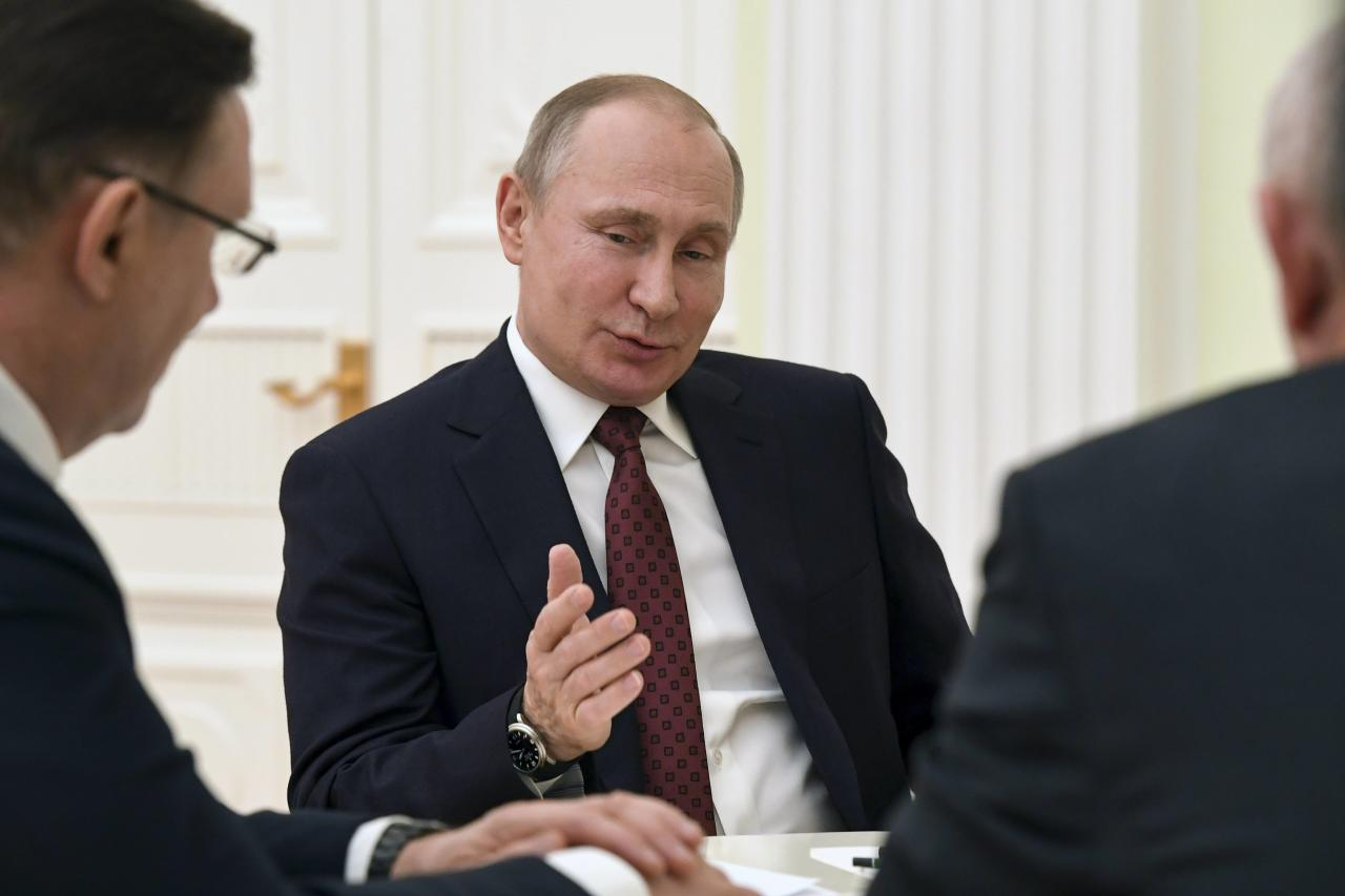 Russian President Vladimir Putin meets with co-chairs of his campaign office at the Kremlin in Moscow, Russia March 19, 2018. Yuri Kadobnov/POOL via Reuters