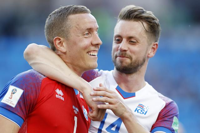 <p>Cheers, mate! Two of Iceland's heroes give themselves a well-deserved pat on the back </p>