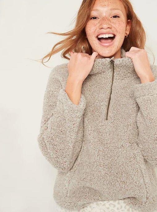 """This Relaxed Cozy Sherpa Half-Zip Sweatshirt for Women is available in sizes XS to XXL and 12 colors.<a href=""""https://fave.co/2Io2kki"""" target=""""_blank"""" rel=""""noopener noreferrer""""> Get it on sale for 50% off (normally $35) at Old Navy</a>."""