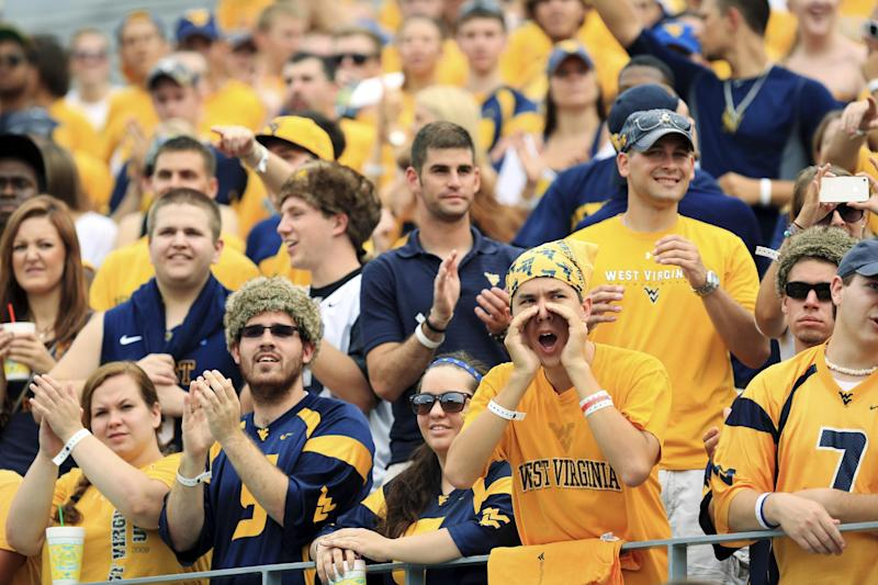 West Virginia students cheer during their NCAA college football game against Marshall in Morgantown, W.Va., Saturday, Sept. 1, 2012. West Virginia won 69-34. (AP Photo/Christopher Jackson)