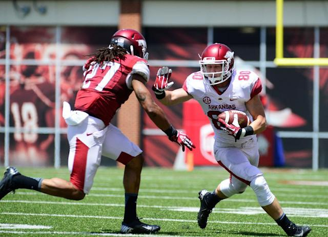 Arkansas wide receiver Drew Morgan (80) fends off safety Alan Turner (27) during their spring NCAA college football game, Saturday, April 26, 2014, in Fayetteville, Ark. (AP Photo/Sarah Bentham)